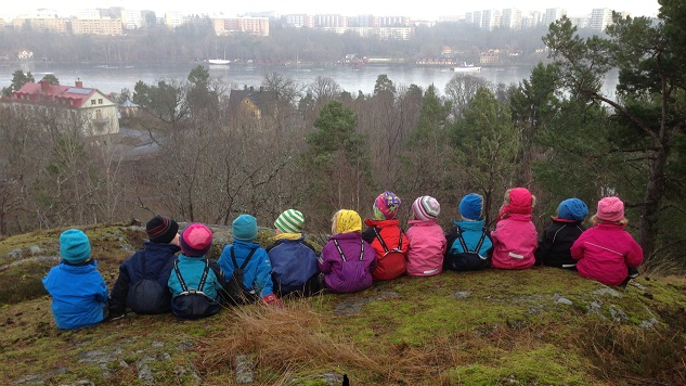 A preschool class looks down at the Stockholm skyline