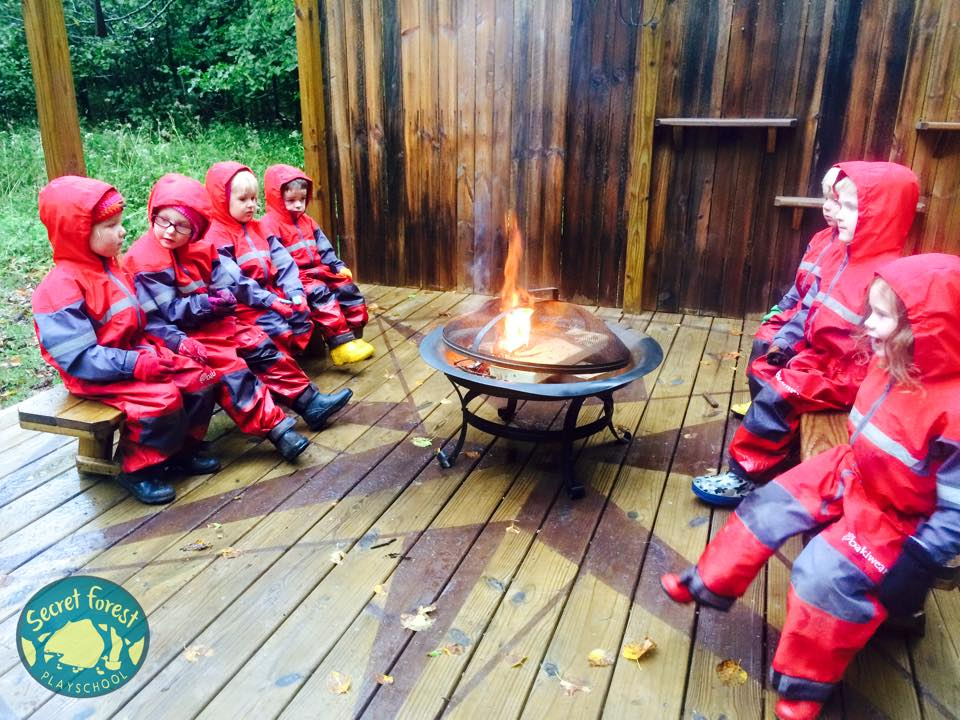 Here's an example from the Secret Forest Preschool in Duluth, MN. They use oakiwear rainsuits over layers that change to fit the season.